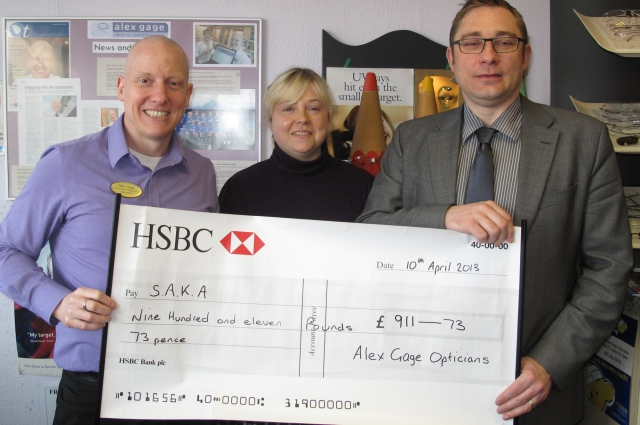 Alex Gage(L) and Cara Smith present a cheque to David Marshall from SAKA r